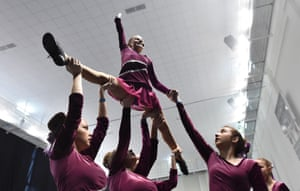 Members of a cheerleading team warm up during the Russian cheerleading championship of students