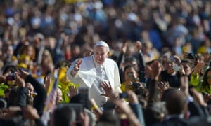 Pope Francis salutes the crowd as he arrives in St Peter's square at the Vatican on 6 November  2013.