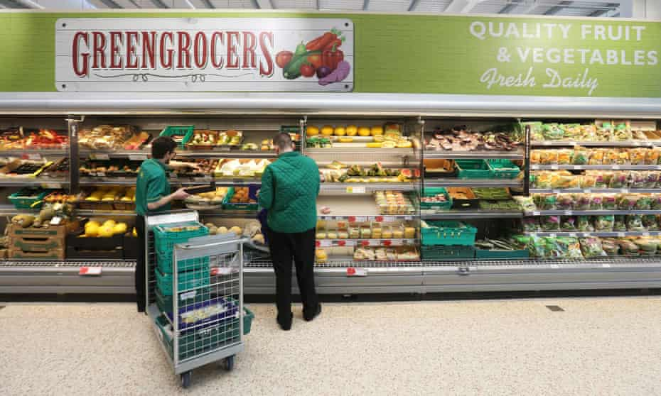 Employees in a Morrisons supermarket.