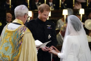 The Prince places the ring on his wife's finger