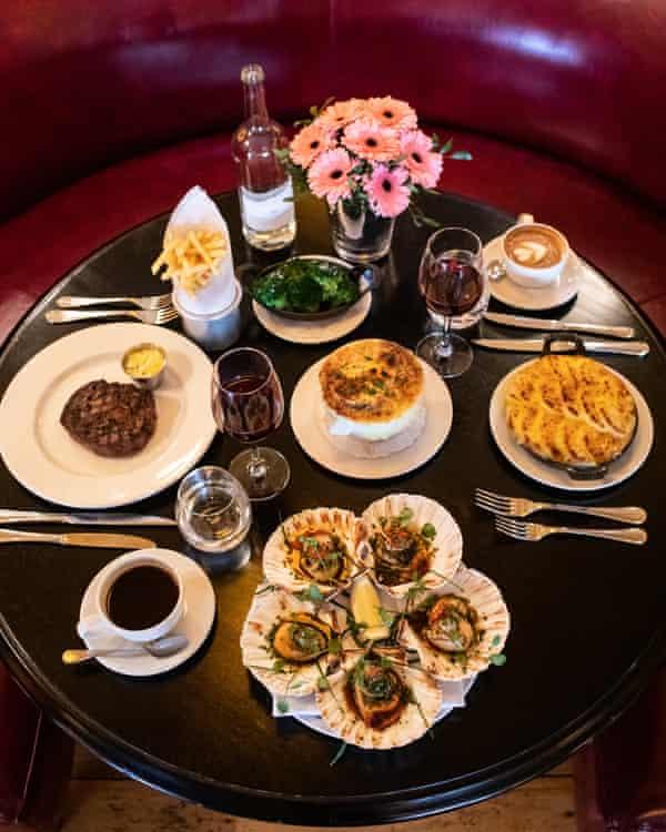 Onion soup gratinée, £9; fish pie, £19.50; broccoli £5; americano £3, baked scallops, £24; steak frites, £27.50; flat white, £3, Carafe of Cotes du Rhone, £21; bottle of sparkling water, £4