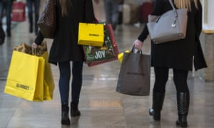 Shoppers with Selfridges bags