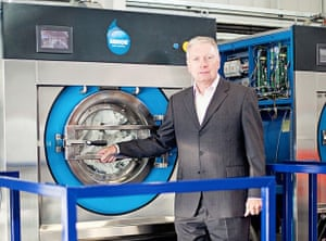 CEO of Rotherham based Xeros, Mark Nichols in front of washing machines which use tiny plastic beads to help clean clothes more efficiently.
