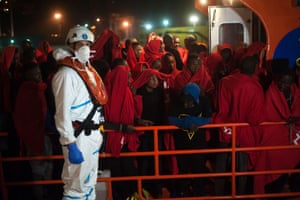 Malaga, Spain A group of migrants wait on a rescue boat after their arrival in Malaga. A total of 115 migrants aboard two dinghies were rescued while crossing the Alboran sea