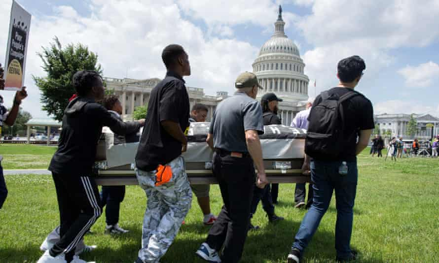 The Poor People's Campaign protest on Capitol Hill by transporting an empty casket symbolizing people who have died from lack of healthcare on 4 June.