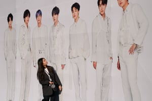 A BTS fan gazes up at her idols.