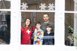 Elizabeth Melinek with husband Jon Hawkins and their sons Jack and Seth