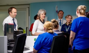 Theresa May visits Alder Hey hospital in Liverpool with the health secretary, Matt Hancock (left), and Simon Stevens, chief executive of NHS England.