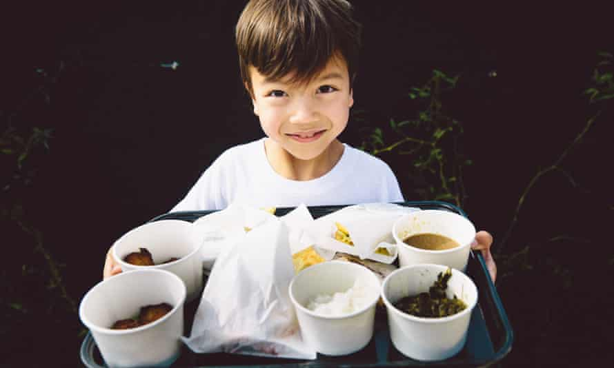 Child showing his tray of LocoL food.