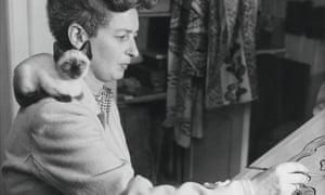 Siamese cat lover Enid Marx at work in her studio.