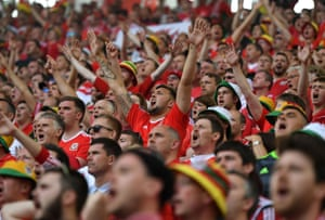 Wales supporters cheer their team on.