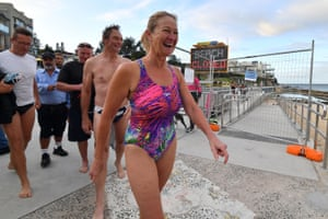 Beachgoers smile as they arrive for their first swim