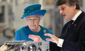Ralf Speth with the Queen during a royal tour of the Jaguar Land Rover engine manufacturing centre in Wolverhampton in 2014