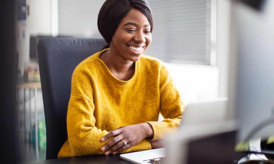 Female executive at her desk working on laptop