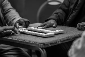 A domino game in progress, from Windrush generation portraits by Jim Grover