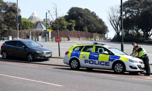 Police stop a car