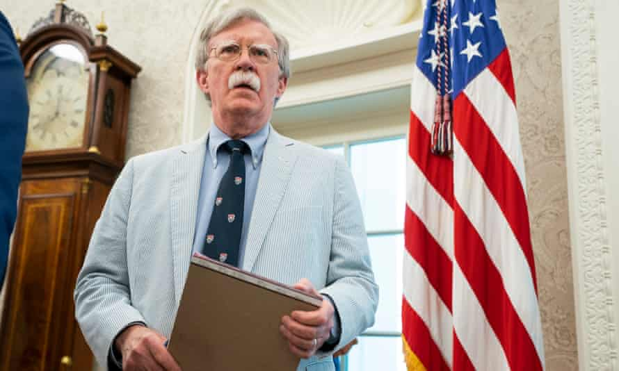 John Bolton – wearing a seersucker suit – waits in the Oval Office in July 2019.