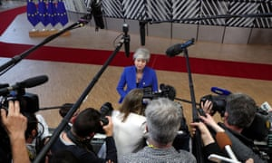 Theresa May speaks to the media as she arrives at a European Union leaders summit in Brussels last month.