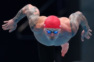 Adam Peaty of Great Britain dives into the water at the start of his men's 100m breaststroke heat.