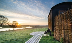 One of Elmley nature reserve's six huts, which offer wetland views, Kent, UK.