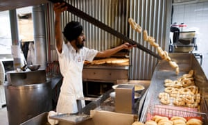 Resham Singh makes bagels at Kettleman's in Ottawa, Canada, October 6, 2018. (Cole Burston)