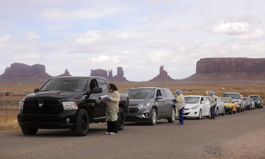 People lined up to get tested for Covid-19 outside of the center in Oljato-Monument Valley, San Juan county, Utah. Photograph: Kristin Murphy/AP