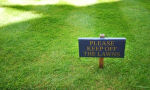 green lawn with sign saying 'Keep off the grass'