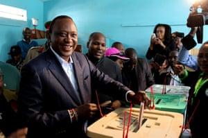 President of Kenya Uhuru Kenyatta casts his vote during the general elections, at the Mutomo Primary School polling station in Gatundu neighbourhood of Nairobi