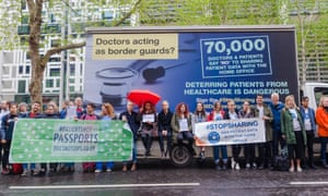 Protesters with a Doctors of the World vehicle spoofing the Home Office 'go home' van