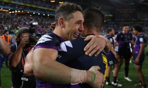 Billy Slater and Cooper Cronk celebrate the Storm winning the 2017 NRL grand final match. Cronk now plays for the Roosters and both men are doubtful for the 2018 grand final.