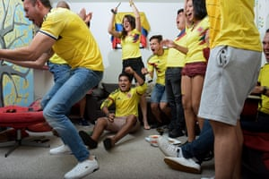 Colombia football fan Erik Sarmiento (sitting on floor) with friends in Manchester, 24 June 2018