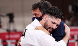 Ariel Torres hugs his coach after winning kata bronze.