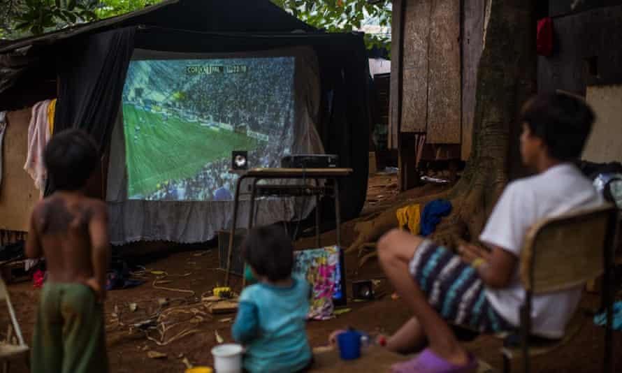 Watching football in Tekoa Itakupe