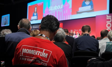 A member of the audience wearing a Momentum T-shirt at the Labour party conference in Brighton on 26 September 2017.