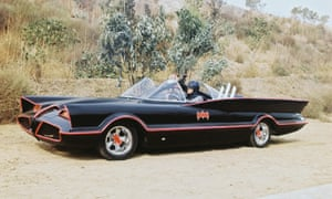 Batman and Robin in the famous Batmobile, which was a modified version of the 1955 Lincoln Futura concept car