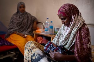 Baby Farhia is cradled by an aunt in the maternity ward of Mudug Teaching Hospital in Galkayo
