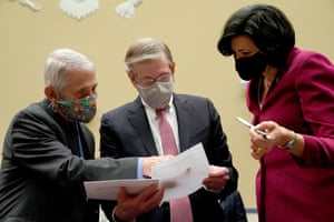 Dr Anthony Fauci, Dr David Kessler and Dr Rochelle Walensky confer before a House subcommittee hearing.