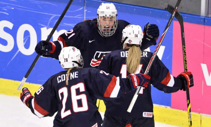 Brianna Decker (c) is congratulated by Kendall Coyne (26) and Hilary Knight (21) after USA beat Canada in Sweden to win the championship two years ago.