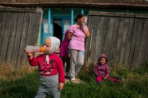 A family waits outside a house without electricity for volunteers to install a solar panel. For five years now the Light For Romania project has been bringing power into some of the lowest-income homes in the European Union's second poorest nation, Gorbanesti, Romania