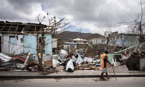 A man walks past hurricane damage in Marigot on the island of St Martin