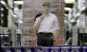 A young Bill Gates poses in Microsoft's warehouse in Redmond, Washington, 1986