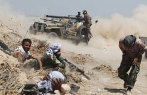 Iraqi pro-government forces fire an anti-tank cannon during a major operation to retake the city from Islamic State