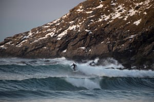 A surfer rides in full flow