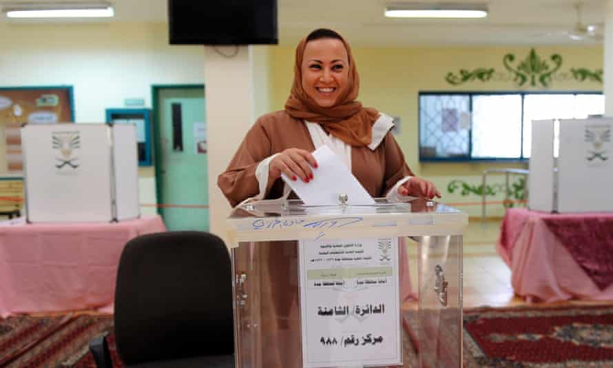 A woman casts her ballot in Jeddah on 12 December in the first Saudi elections to allow women to vote.