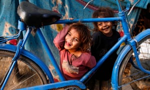 Street children play on a roadside in Allahabad, India
