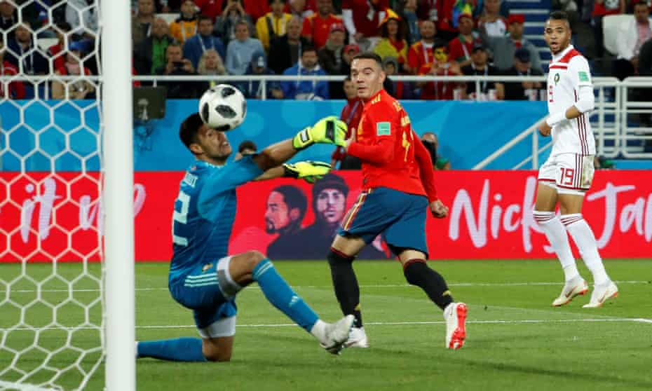 Spain's Iago Aspas scores their equalising goal to salvage a point against Morocco and mean they topped Group B and will face Russia in the last 16.