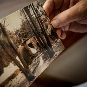 Black Saturday bushfire survivor Deb Morrow with images of her home