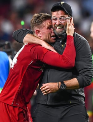 Liverpool Manager Jurgen Klopp and Captain Jordan Henderson of Liverpool are in tears as they celebrate at the end of the game.