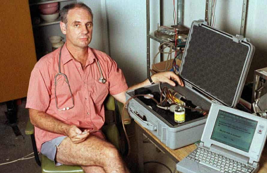 Philip Nitschke in June 1996 with his euthanasia delivery system, which comprised a laptop computer and a box containing a syringe, which was connected to the patient by an intravenous line and driven by compressed air
