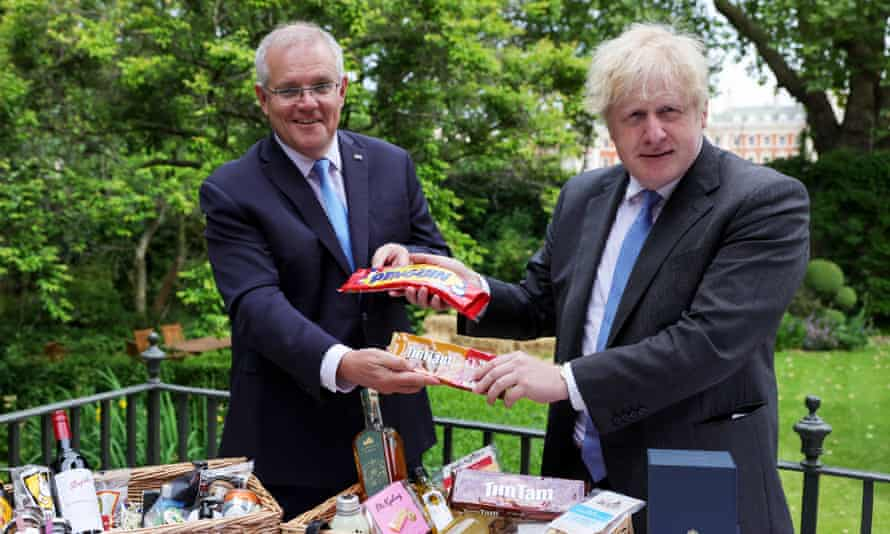 The leaders swap biscuits as they announce the trade deal